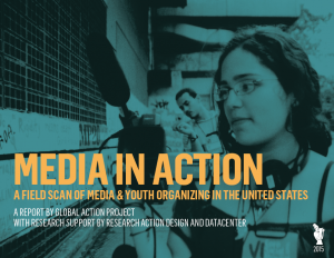 Background image of person in glasses holding recording equipment - Media In Action text overlaid on the image